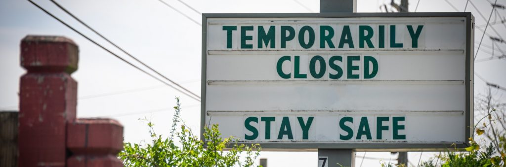 A sign saying that a business is temporarily closed due to the pandemic.