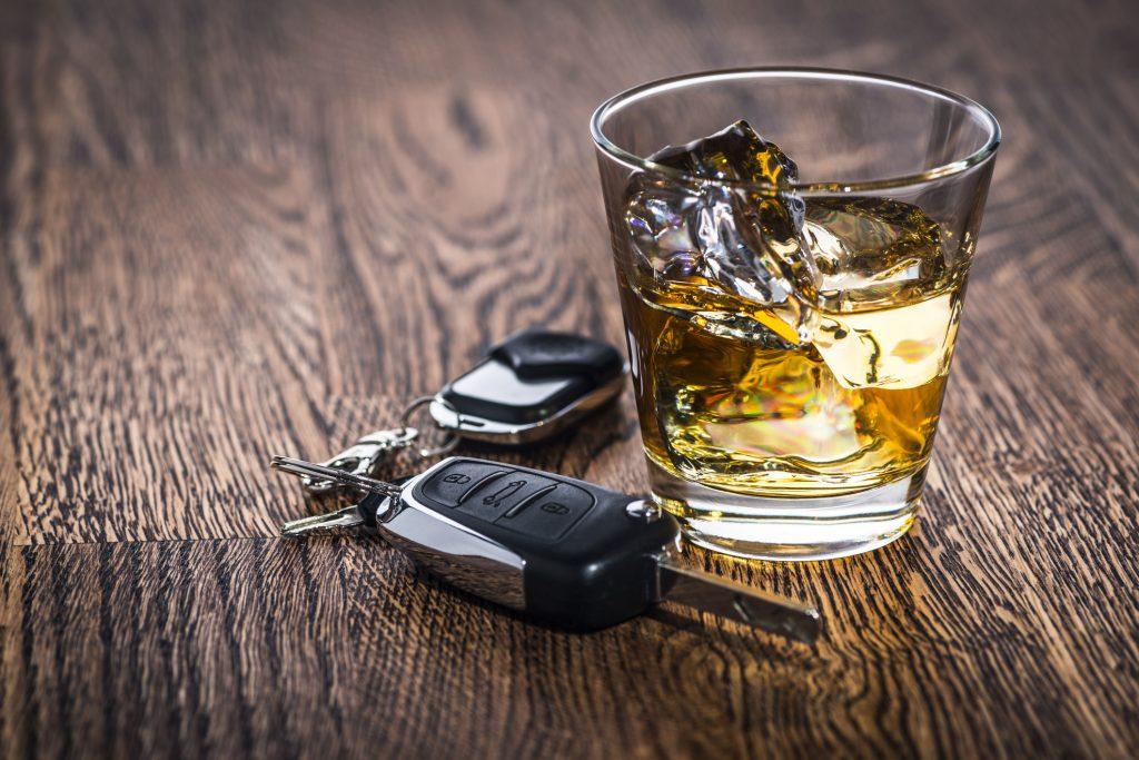 Car keys next to an alcoholic drink
