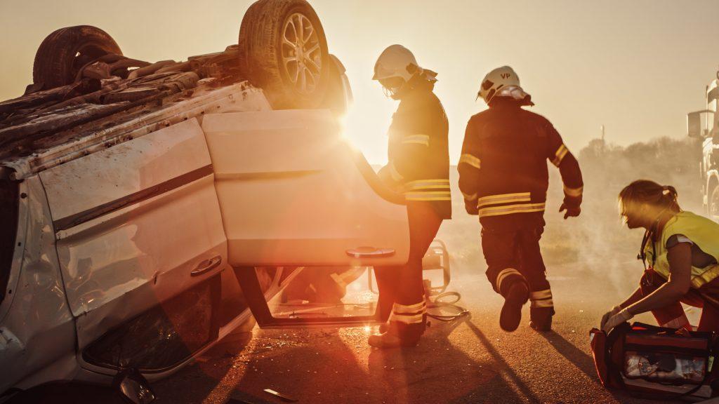 Paramedics responding to a rollover car accident
