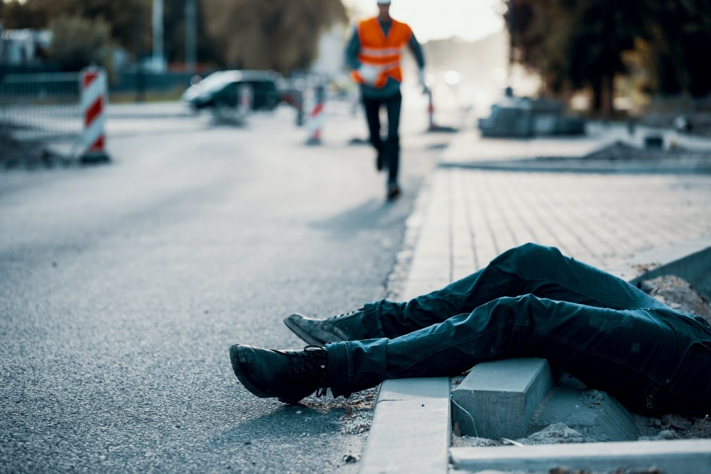 Woman laying on sidewalk after a fall