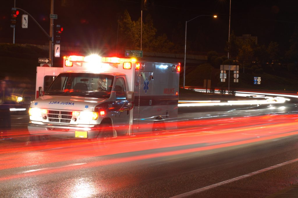 Ambulance with lights on in traffic