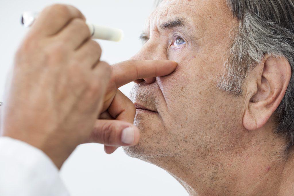 Elderly man receiving an eye examination